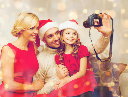 Taking a family photo for the best holiday photo gifts