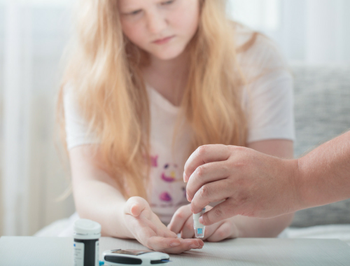 Teen with type 1 diabetes monitors her blood sugar