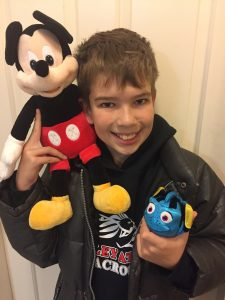 Liam enjoying his Scentsy Disney Products